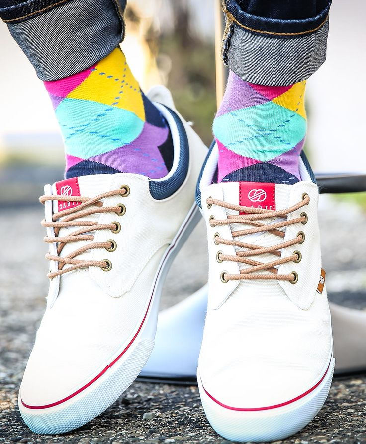 Argyle is a timeless classic, but when you add some contemporary colors like purple and yellow, it becomes a brilliantly bold power sock. Shop these socks and more. c/o Radii Shoes.