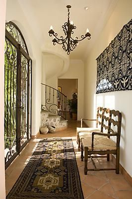 love the iron door (may be on windows...hard to tell and no link)... Maybe for the back patio?