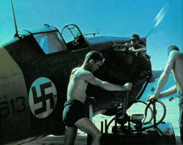 FINNISH AIR FORCE and GROUND CREW working on a Morane Saulnier MS 406