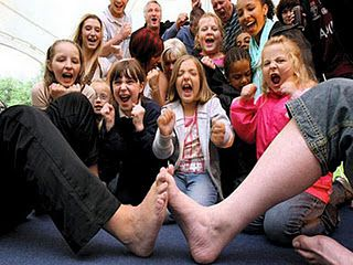 Weird Sports: Toe Wrestling  Toe wrestling is a childhood game which has made into the adult gaming world. The rules are not different from the childhood version of the game. Competitors face each other toe-to-toe, across the toedium, interlocking their toes and trying to force each other off the toedium. Surprisingly, Toe wrestling has its own world championship which takes place annually to crown champion toes.