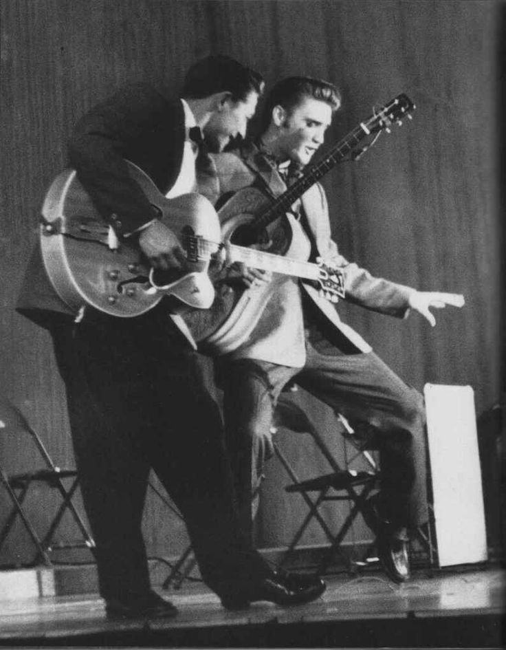 Scotty Moore and Elvis Presley.