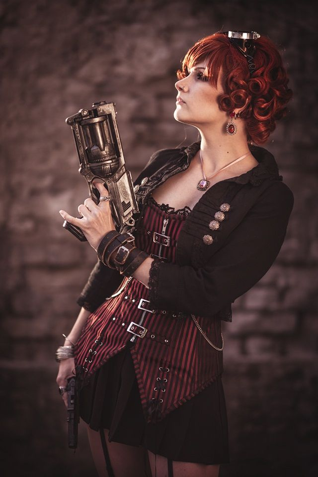 Redhead steampunk sharpshooter, striped red corset with a nerf gun and goggles. Photo: Samu Hupli
