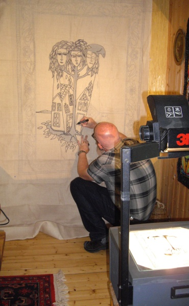 Rug hooking artist Hakon Gron Hensvold using a projector to transfer a design