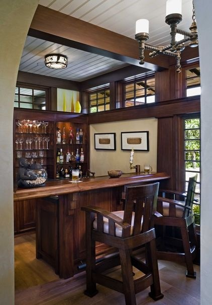 This wet bar features a hinged section of the counter:  lift up and gain access to the bar area. Sweet!   (tropical wine cellar by Ike Kligerman Barkley)