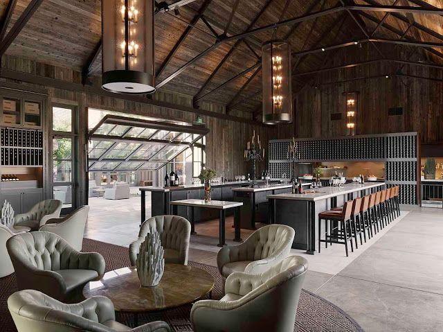 Love the industrial/barn vibe. Concrete floors, open floor plan and of course the garage door!
