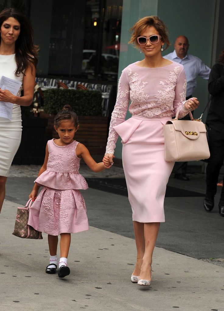 Jennifer Lopez with daughter Emme Lopez in identical pink dresses.