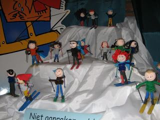 Paperdoll skiers with photos of the kids' faces...