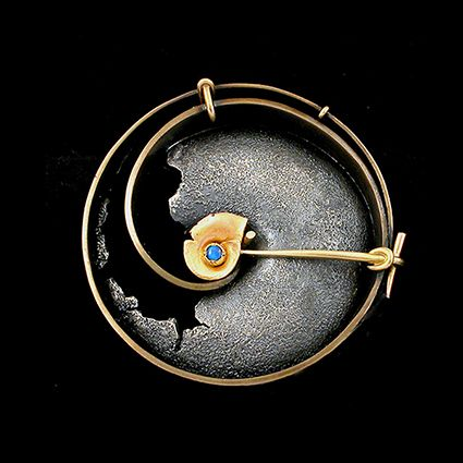 Andy Cooperman - Moonsnail Brooch. 18K Gold, 14K Gold, Sterling Silver & Bronze with Opal. Seattle, Washington. Circa Early-21st Century.