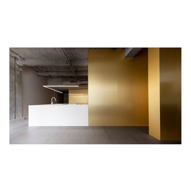 •• brass, raw concrete and a white bathroom sheated in marble brought together in a minimalistic yet theatrical composition •• #jeanverville #architect #interior #interiordesign #bathroom #marble #gold (photo maxime brouillet)