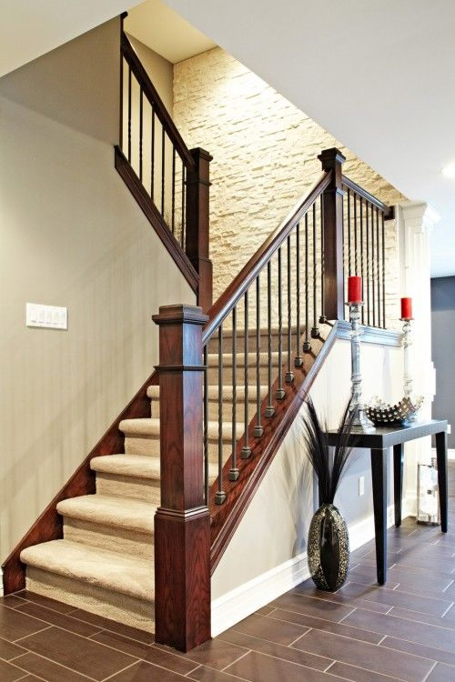 wood steps instead of carpet and this would be really pretty. Love the stone accent wall.