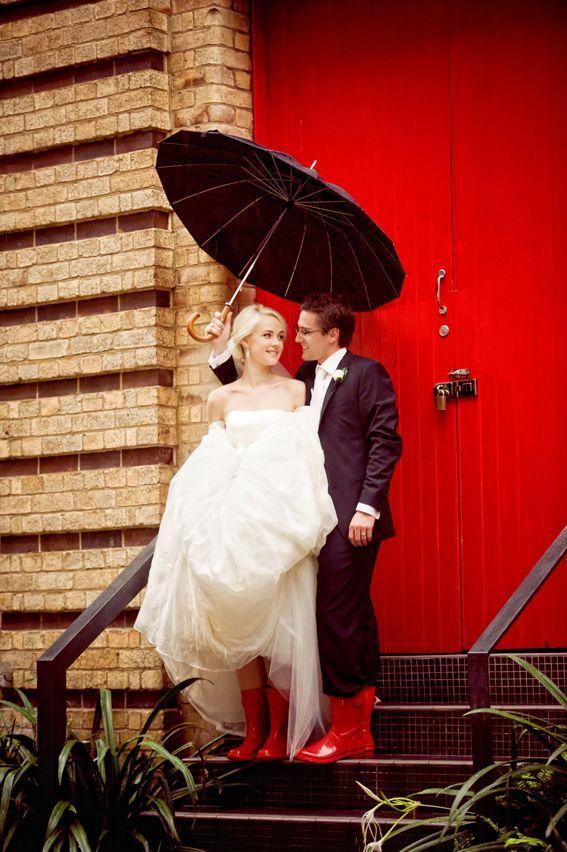 Red rain boots; Red door