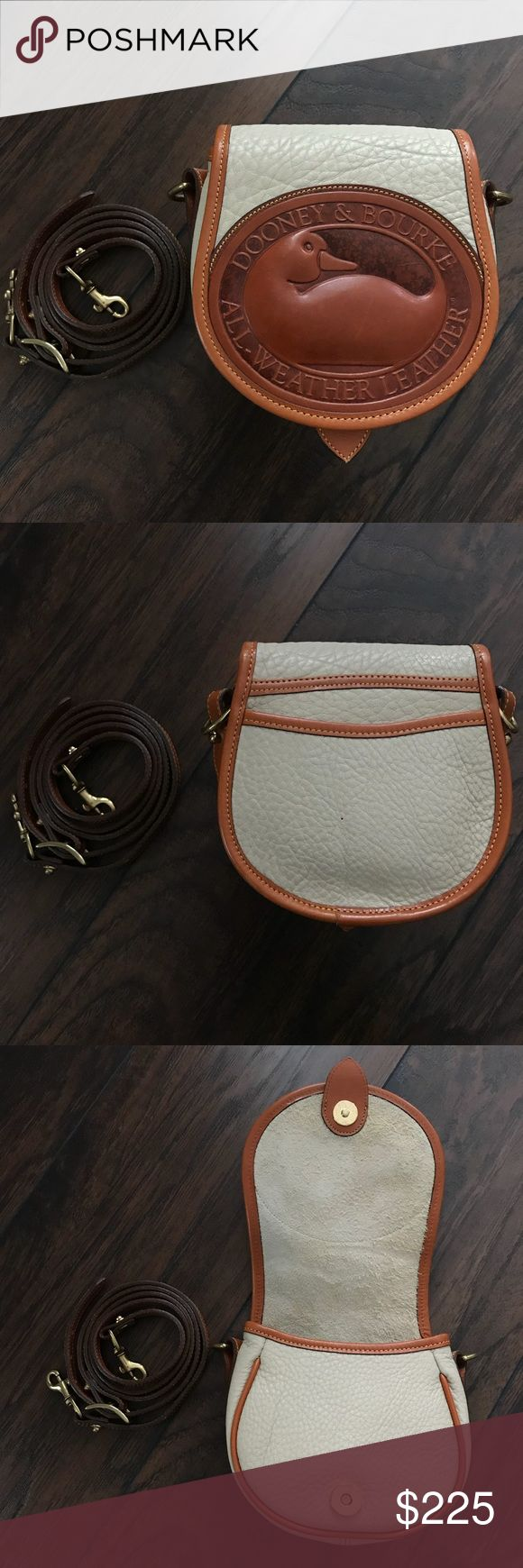 """Vintage Dooney and Bourke AWL Big Duck bag bone Vintage Dooney and Bourke All Weather Leather Big Duck bag in bone and British tan. Super hesitant to let this one go 😫 perfect little bag for any D&B lover. Small pinhole in back as seen in second picture, interior tag has been cut out, no fob. Otherwise great preowned condition! 6.5"""" x 7"""" x 3"""". Exterior back slip pocket &  interior main compartment with back slip pocket. Magnetic closure, brass hardware, adjustable strap 45""""-50"""" (can be worn…"""