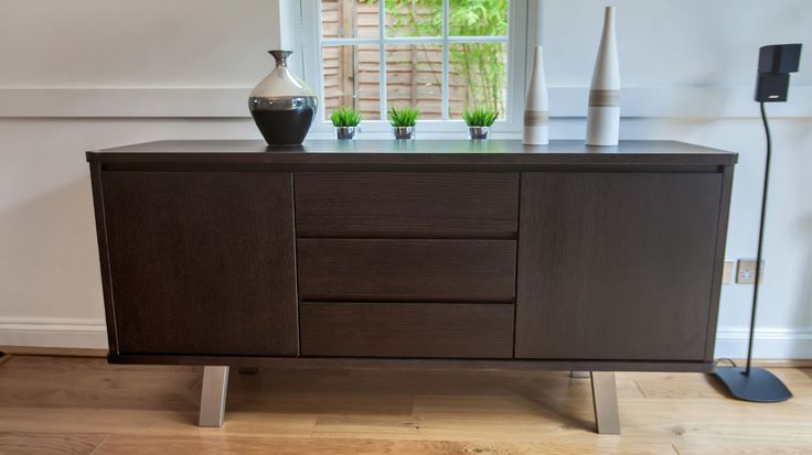 The rich, dark colouring of this Assi Wenge Wood Sideboard will add a sophisticated and sleek ambiance to any room in your home.