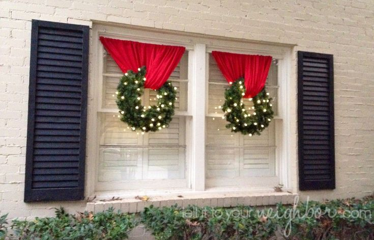 I love how they hung these! Tension rod and curtain, rod loop on each end, curtain through wreath and ends of curtain on rod. #exteriorchristmaslights