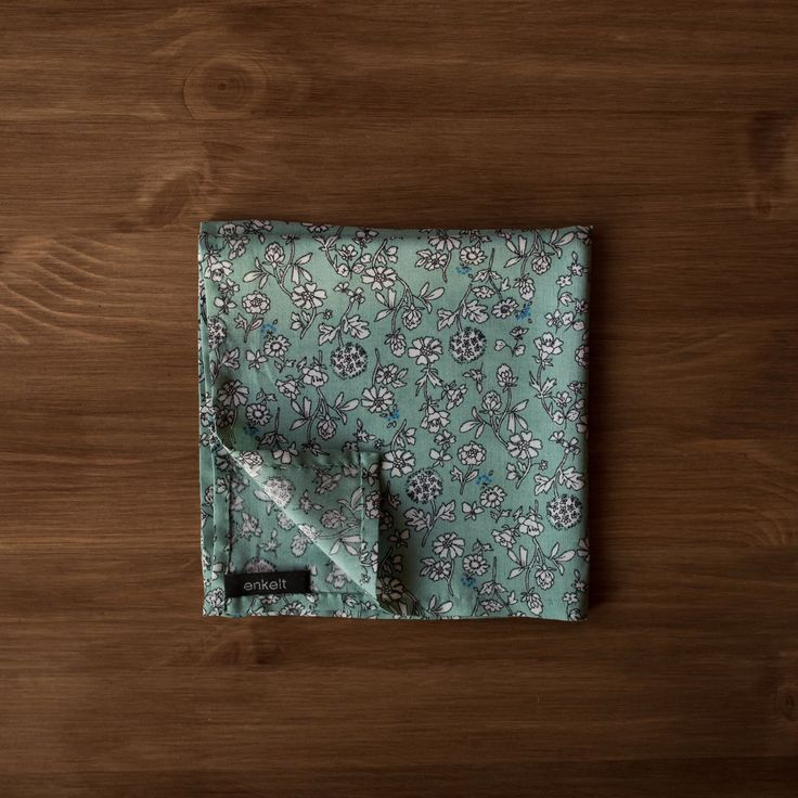 New to the shop today - a cotton-silk sage green with a white floral print pocket square. Just the thing for spring!
