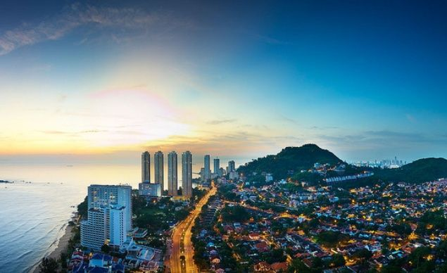 An aerial view of Penang as  evening falls over the multicultural island, which makes room for beach resorts,  preserved mangroves, small fishing villages, and a share of temples, mosques,  and churches.