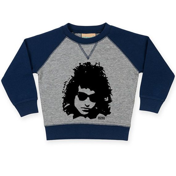 Bob Dylan Baby Raglan Sweatshirt Bob Dylan Toddler Jumper/ Details  Snuggle your little one in this cozy contrast raglan sweatshirt with the print of their favourite singer Bob Dylan.   LISTING INCLUDES: Larkwood unisex baby and toddler contrast raglan sweatshirt with a Bob Dylan print.   #cute #organic #toddler #shirt #bob_dylan #cool #clothes