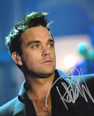 See Robbie Williams perform twice! <3