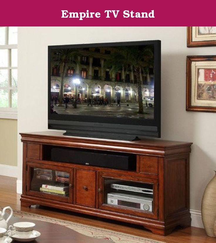 Empire TV Stand. ZA-E1462 Features: -Elegant traditional Louis Philippe style and beautiful shaped moldings. -Two wood frame tempered glass doors. -Two adjustable inside shelves. -Middle door is a ball-bearing glide slide-out tray and has two shelves for storage. -One large 40'' opening at top with a support that is set back about 8'' from the front. -Black fabric grill comes with this unit and can be used if desired. Product Type: -TV stand. Design: -Enclosed storage. Finish: -Classic...