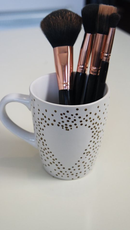 Polka dot effect heart mug. Style it out and use it as your perfect makeup brush holder