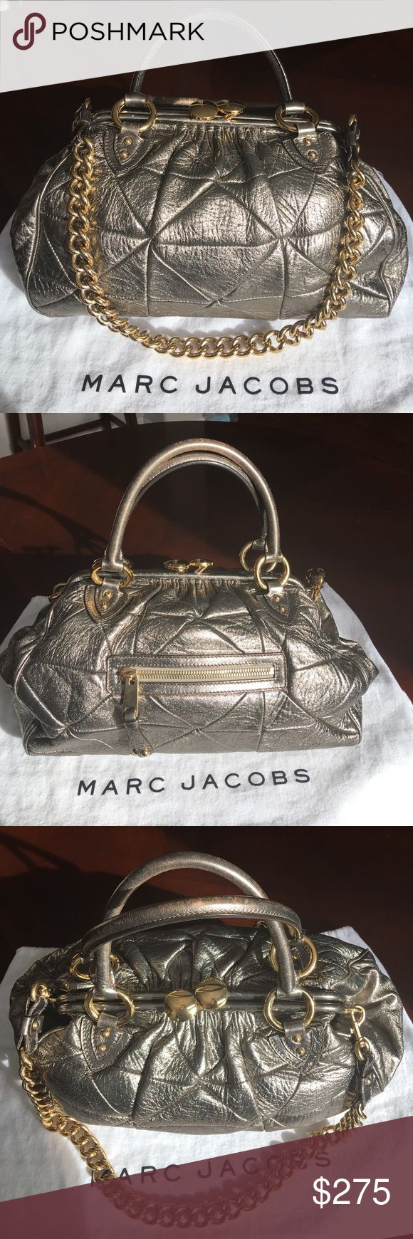 "HP! 1/28MARC JACOBS Patchwork Stam Bag EUC! This is an authentic Marc Jacobs Patchwork Stam bag!  I was on a search for silver/pewter one and this beauty arrived a gorgeous golden color. I would keep her but I have a great gold bag gifted to me by my daughter. Great overall condition: wear on the handles (pic#2) and tiny spot inside (#3). 14""x10""x5"", kiss-lock, removable shoulder chain. Stams are an ultimate bag for chic, amazing style! From jeans & T-shirts to glam, anything goes with this…"
