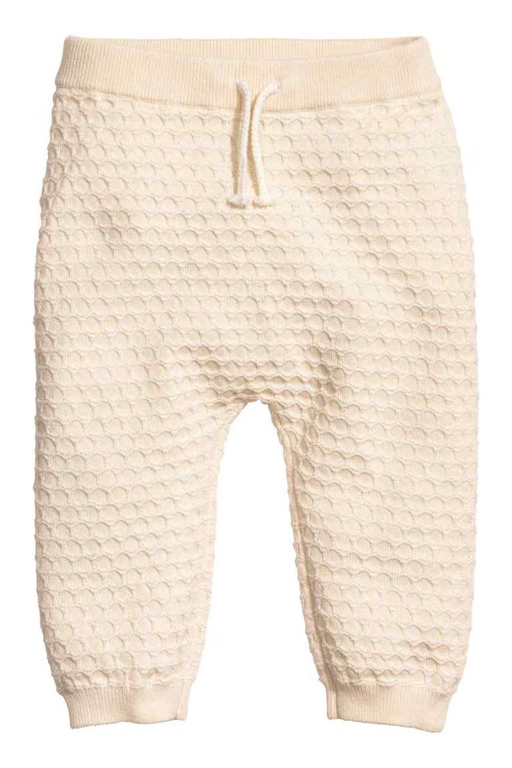 Trousers in a textured knit: BABY EXCLUSIVE/CONSCIOUS. Trousers in a soft, fine, organic cotton textured knit with an elasticated waist, decorative tie and ribbed hems.