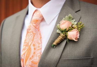 Peach tie and boutonniere.  Florals by Poppy Lane Design.  Photo by Holli B Photography.