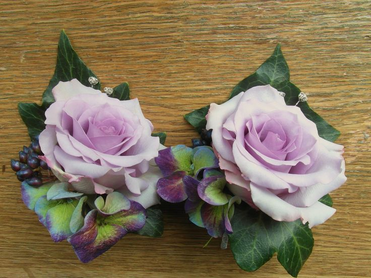 Purple corsages with ocean song roses, hydrangea, viburnum berries and ivy.