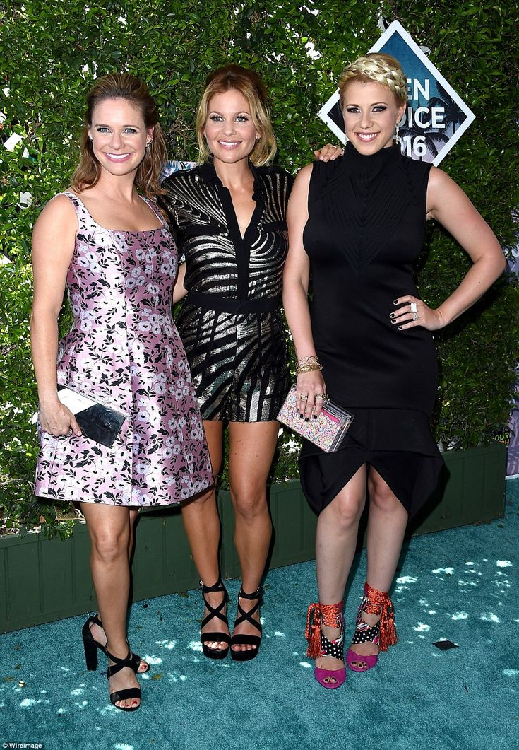 Trio: Candace Cameron Bure was buffered by her Fuller House co-stars Andrea Barber and Jodie Sweetin