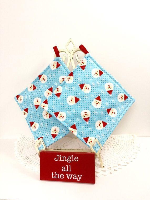 Creo en la Santa Navidad almohadillas  agarraderas por SisterOnions