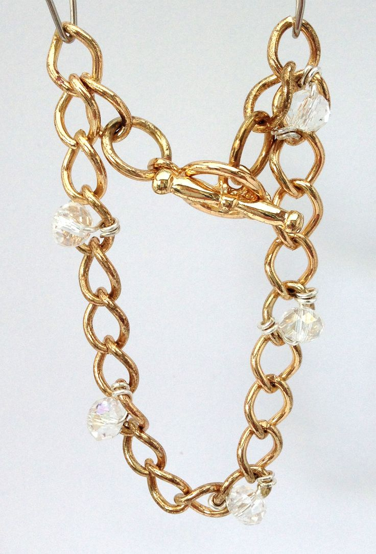 Bracelet with small crystal beads wired between links