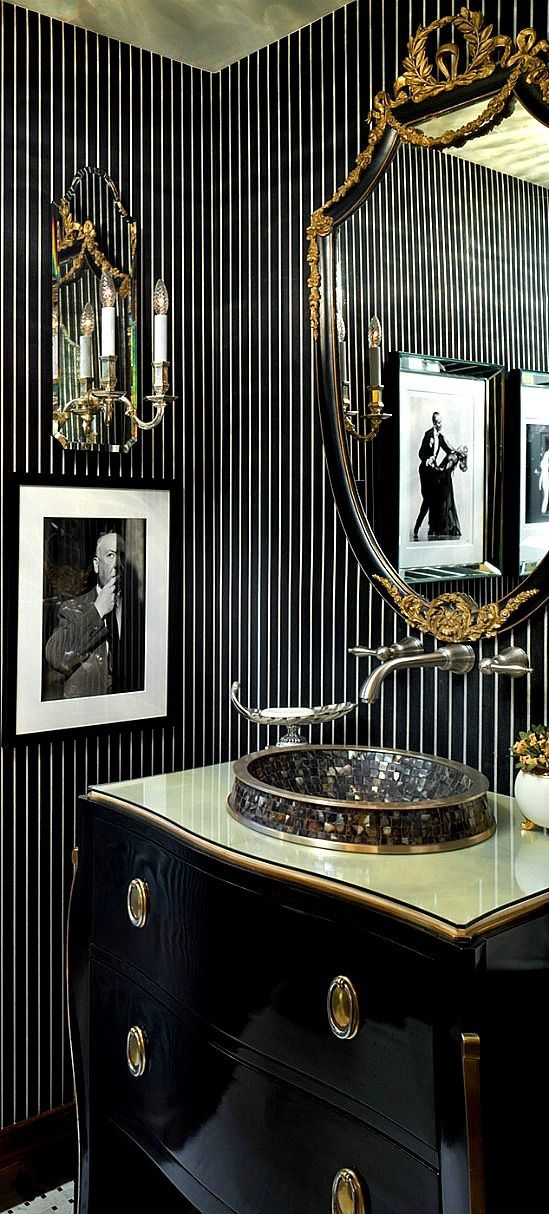 Masculine powder room with dark palette and black and white striped wall treatment