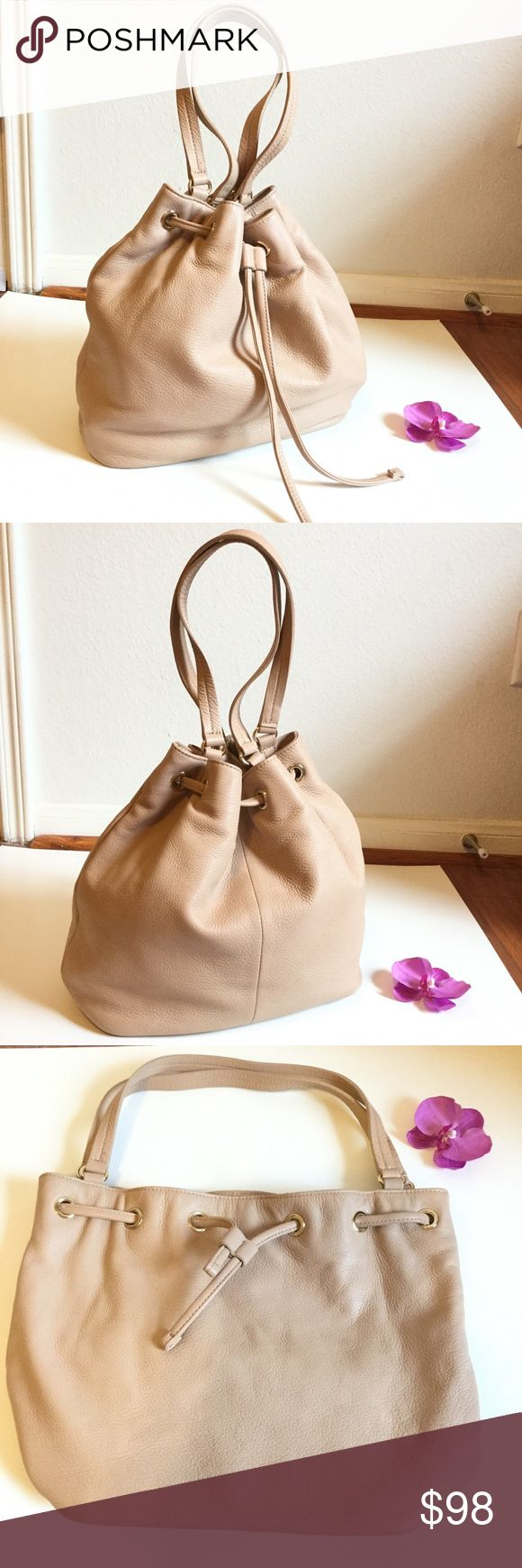 TALBOTS LEATHER BUCKET  BAG👜 Gorgeous soft genuine leather bucket handbag from TALBOTS. In beautiful color tan. Gently worn about 3 times, in excellent condition. Very clean inside and out. 100% cotton lining. Hold so much stuffs, one zipper pouch, 1 phone pouch, & 1 accessory pouch. Shiny gold hardware. Great size for every day essentials,original: $200 + tax. Pls no low ball offer. Poshmark takes 20% fee. Thanks for shopping ❤️🌹 Talbots Bags