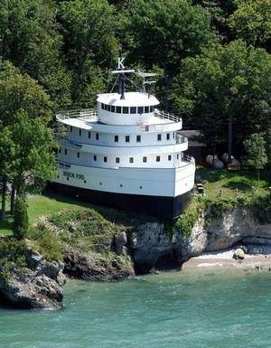 Why not live in a ship!? ~ This was a lake freighter on the Great Lakes and was turned into a home on the island of Put-In-Bay, Ohio, location of several battles of the War of 1812.
