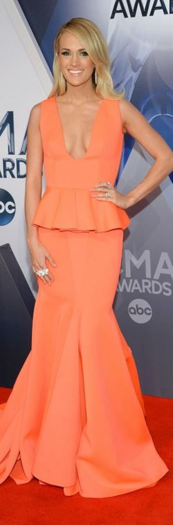 Who made Carrie Underwood's jewelry and orange peplum gown?