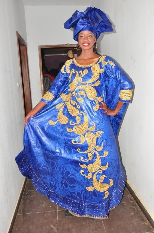 Have this dress custom made for you in your preferred color and length without any extra charge.  Fabric: brocade Lined: fully Bottom: Wrap