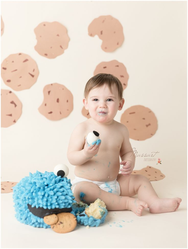 One year milestone baby boy photo shoot in studio; Cookie