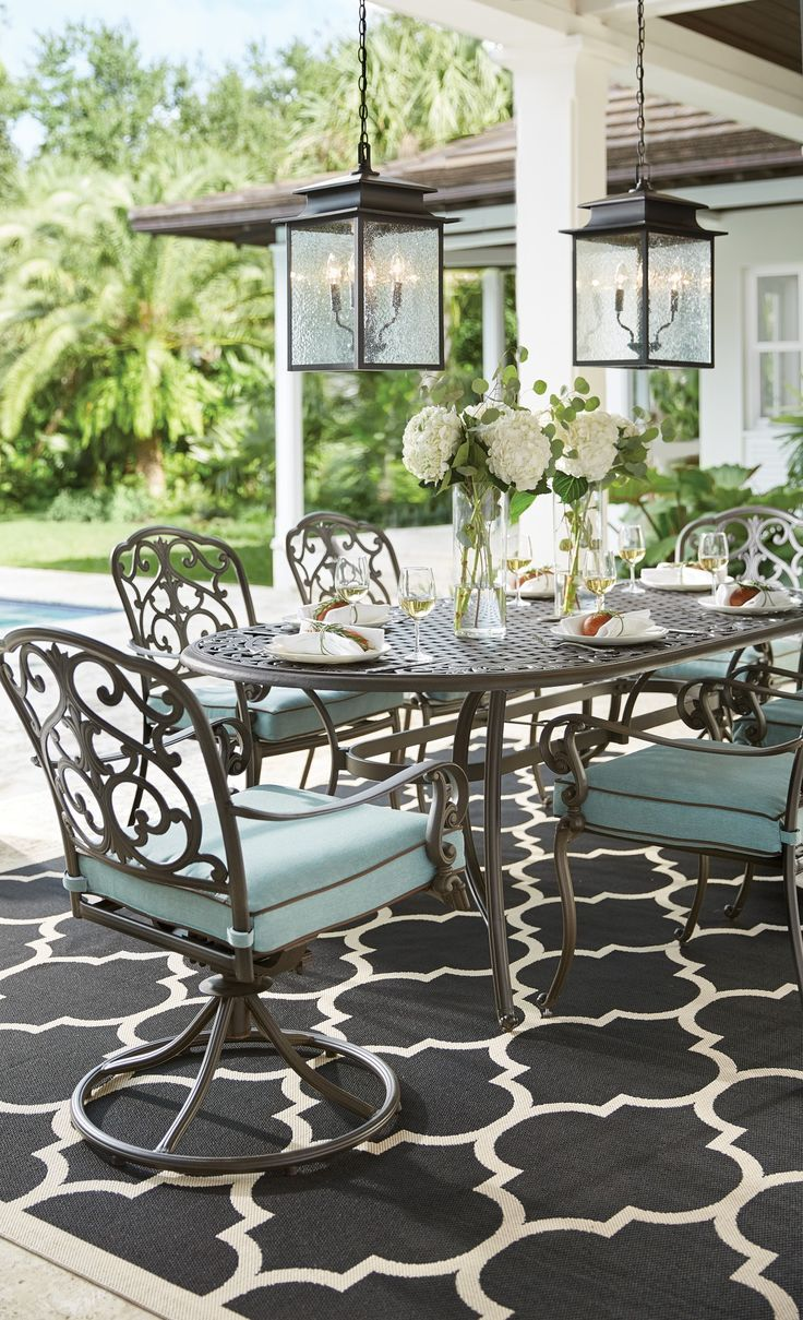 Cannot get enough of the Madrid Dining Set. This seven-piece outdoor set is made of cast aluminum and olefin fabric. Two of the six dining chairs are swivel rockers. The bronze finish with contrasting blue cushions give it an elegant look. Enjoy entertaining outside all season long with this patio furniture. Shop at Home Decorators Collection.