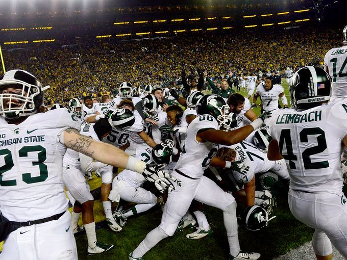 Michigan State players celebrate in the endzone after