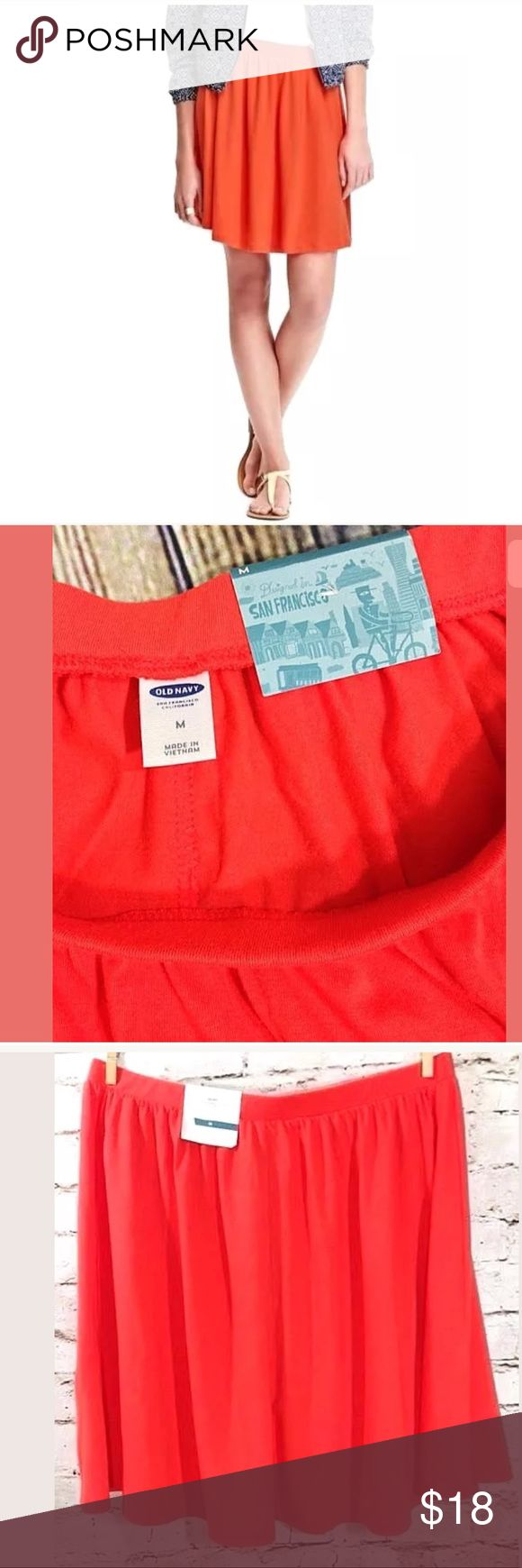 """New Old Navy Orange Skirt Jersey Knit Sz Medium NWT Old Navy Skirt  Women's Size Medium 62% Polyester / 34% Rayon / 4% Spandex New with partial tags attached Above knee style San Francisco Jupe Skirt Solid orange color  Stretch jersey knit fabric Waist= 30"""" (unstretched) Length = 17""""  Thank You For Your Business! Old Navy Skirts"""