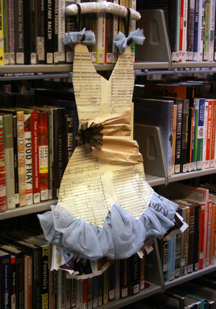 Dress made from discarded book pages for library fashion display.