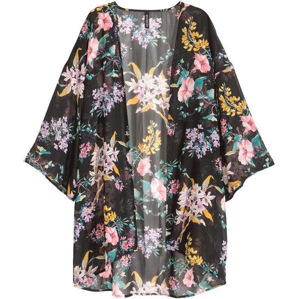 Zwart/bloemen. Een kimono van fijne, geweven kwaliteit met driekwart mouwen. Geen sluiting.