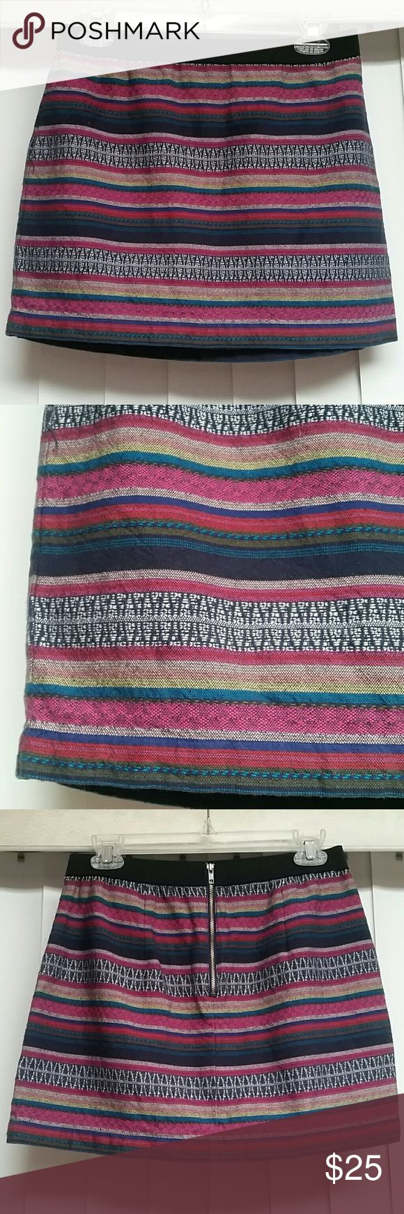 ♡American Eagle southwest tribal embroidered skirt American Eagle Outfitters embroidered mini skirt in a  colorful southwest tribal print design! It is a size 4! =) Worn just a few times! Perfect for Fall layering... Adorable with a cream sweater and boots ♡  Artisan cool. 100% Cotton Soft embroidered cotton. A-line silhouette. Contrast elastic waist. Exposed back zip. Unlined. Machine Wash. $55.00 American Eagle Outfitters Skirts Mini