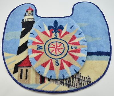 Lighthouse bathroom mat with nautical compass toilet seat cover...