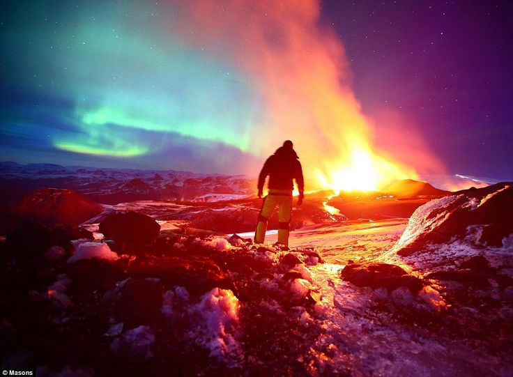 Yet another gorgeous picture of Iceland. The northern lights dancing above the erupting Eyjafjallajökull volcano. Someday I hope to see this sight...