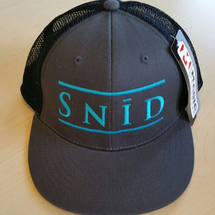 Snid charcoal trucker hat. Bright embroidery for spring. Available for pre-sale. Message us at www.snidclothing.com will be available soon.
