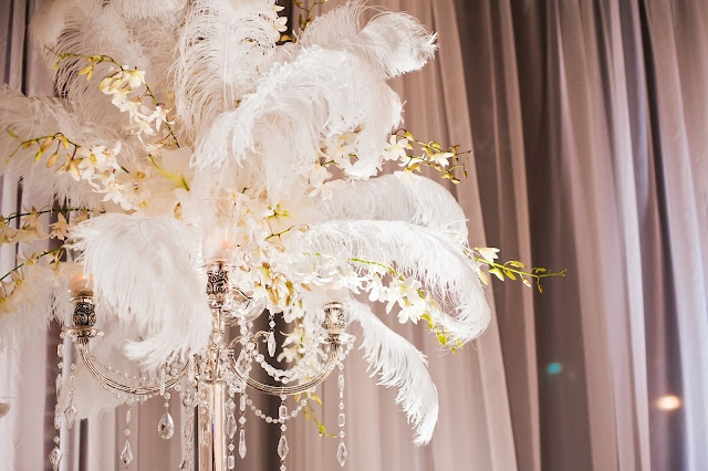 Ostrich feather centerpieces on chandelier candelabra with
