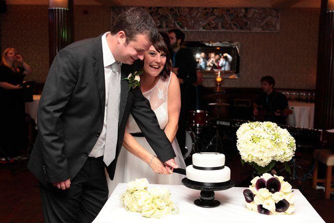 Cutting the wedding cake at the Gatsby Berkhamsted Hertfordshire