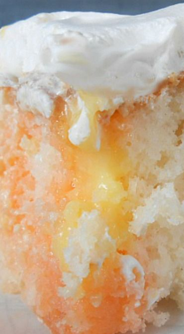 Orange Dream Cake ~ A delightful blend of Cake and jello and pudding and cream... Light and refreshing