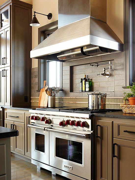 A traditional-shape vent hood is made contemporary with a stainless-steel finish. The size of the hood works well with the other large-scale pieces in the kitchen.